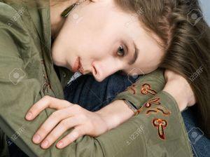 3120617-Portrait-of-sorrowful-girl-putting-head-on-knee-Stock-Photo